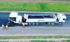 KEITH V-FLOOR® WALKING FLOOR® system unloading asphalt