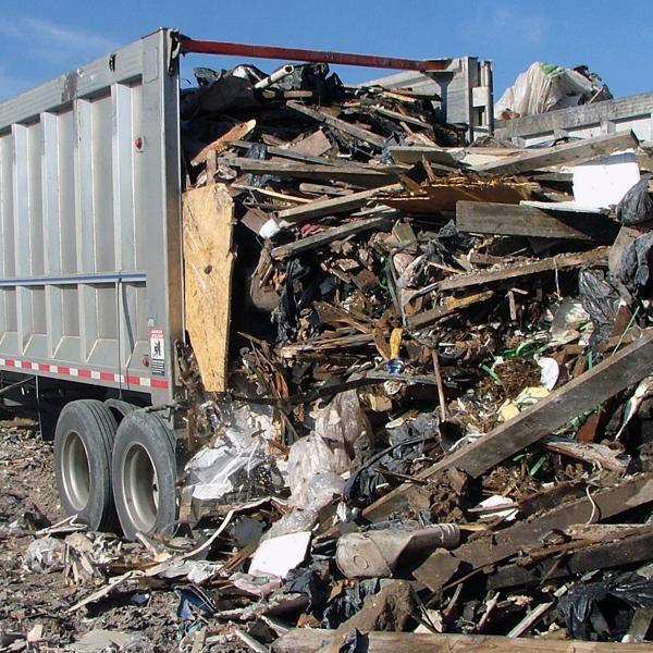 KEITH® WALKING FLOOR® System Unloading Cu0026D Debris. Cu0026D Debris